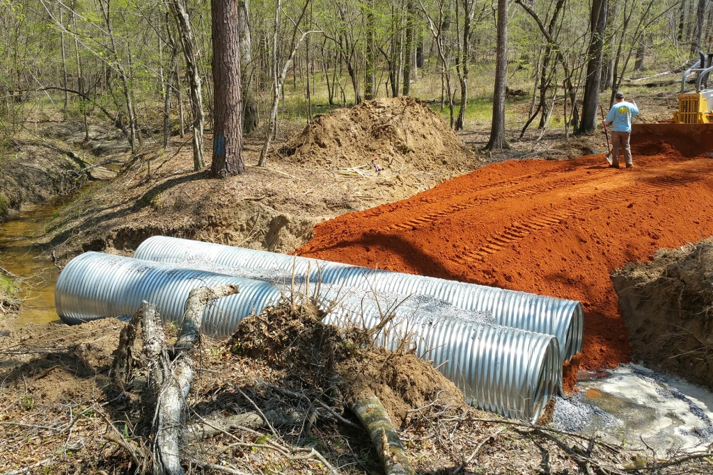 Creek crossing installation for a new road on a rural property.